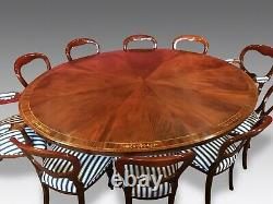 7.3ft Amazing Sunburst Flame mahogany Oval Grand dining table. French polished