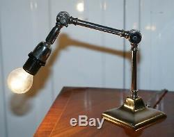 Pair Of Small Solid Polished Metal Table Lamps With Two Points Of Articulation