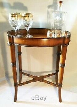 Vintage Chippendale style side table. Bar cart with elegance. Jeanne Reed's